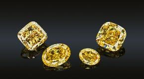 Set of luxury yellow transparent sparkling gemstones of various cut shape diamonds collage isolated on black background.  Stock Photo