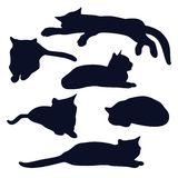 Set of lying black cats silhouettes in various poses. stock illustration