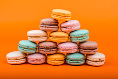 Set of macarons on orange background. Set of macarons isolated on orange background Stock Image