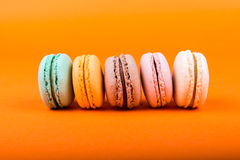 Set of macarons on orange background Royalty Free Stock Image