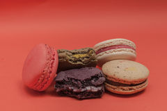 Set of macarons in various colors. Some of them are bitten. Set of macarons in various colors. Some of them are bitten stock photo