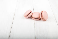 Set of macarons on white wooden table. Set of macarons isolated on white wooden table Royalty Free Stock Photography