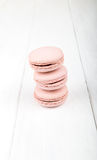 Set of macarons on white wooden table. Set of macarons isolated on white wooden table Stock Image
