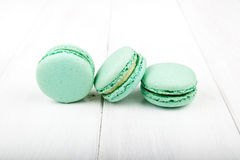 Set of macarons on white wooden table. Set of macarons isolated on white wooden table Stock Photos