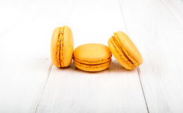 Set of macarons on white wooden table. Set of macarons isolated on white wooden table Stock Images