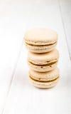 Set of macarons on white wooden table. Set of macarons isolated on white wooden table Royalty Free Stock Photos