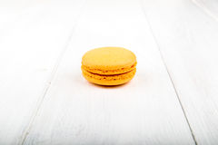 Set of macarons on white wooden table. Set of macarons isolated on white wooden table Stock Photo