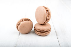 Set of macarons on white wooden table. Set of macarons isolated on white wooden table Royalty Free Stock Image