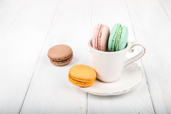 Set of macarons on white wooden table. Set of macarons isolated on white wooden table Royalty Free Stock Images