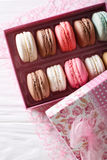 Set of macaroons in a pink gift box close-up on a table. Vertica Royalty Free Stock Photos