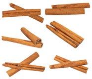 Set macro cinnamon sticks isolated on white Royalty Free Stock Photos
