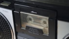 Magnet tape start playing. Set magnet tape cassette into deck and start playing stock video footage