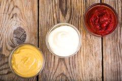Set majonez, ketchup i musztarda trzy klasyków, Fotografia Royalty Free