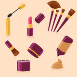 Set of make up. Set of different purple and golden make up tools Royalty Free Stock Photos