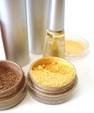 Set for make-up. (golden eyeshadows, rouge and nail polish Royalty Free Stock Photos