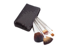 Set of make-up brushes in bag isolated on white Stock Photography