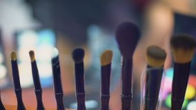 Set of make-up brushes close-up, fashion show backstage, cosmetics industry. Stock footage stock video