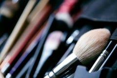 Set of make-up brushes. Tools for professional visage, maskara, eyeshadows, foundation, lipstick, blush and facial cream royalty free stock images