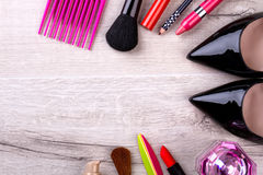 Set of make-up products. Comb, shoes and perfume. Use make-up to emphasize beauty. Quality cosmetics means higher expenses Royalty Free Stock Images