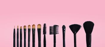 Set of makeup brushes on colored composed background royalty free stock photos