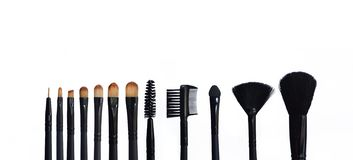 Set of makeup brushes on colored composed background stock photo