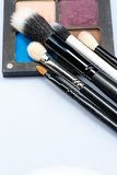 Set of makeup brushes on eye shadow palette Royalty Free Stock Images