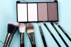 Set of makeup brushes. And highlighter for face tone. fashion. space for text Stock Photo