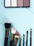 Set of makeup brushes. And highlighter for face tone. fashion. space for text Stock Images