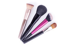Set of makeup brushes isolated on white background closeup Stock Photos
