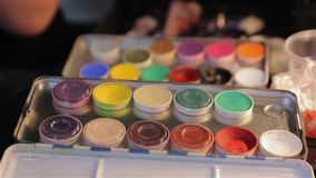 The Set Makeup Paints. Professional multicolored palette brush makeup artist for cinema actor stock footage
