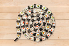 Set of maki sushi and rolls at wood. Stock Photos