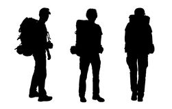 Set of male backpacker silhouettes. 3 black silhouettes of male backpackers waking and standing, carrying big tourist bags Stock Illustration