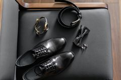 Set of male clothes and accessories. The groom is gathering in the morning. Kit on black chair. Business style. Set of male clothes and accessories. The groom is Royalty Free Stock Photos