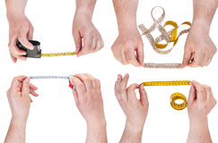 Set of male hands with measuring tapes isolated Stock Images