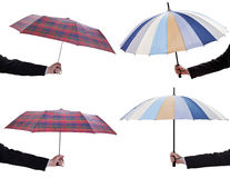 Set of male hands with open telescopic umbrellas Stock Photo