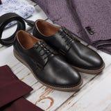 Set of male stylish clothes on wood background. Set of male stylish clothes and shoes on wood background Stock Photos
