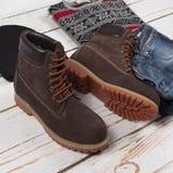 Set of male stylish clothes on wood background. Set of male stylish clothes and shoes on wood background Royalty Free Stock Photos