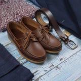 Set of male stylish clothes on wood background. Set of male stylish clothes and shoes on wood background Stock Photography
