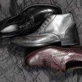 Set of man footwear on a black background. Set of trendy man footwear on a black background Stock Images