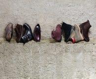 Set of man footwear on a grunge  background. Set of trendy man footwear on a grunge background Stock Photos