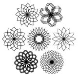 Set of mandala flowers. Black silhouettes. Of seven different objects Stock Photography