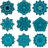 Set of mandalas snowflackes. Drawings of different mandalas in blue in the geometric style Royalty Free Stock Photography