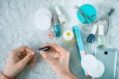 Set for manicure with laptop and smartphone hads paints nails Stock Photo
