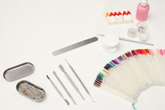 Set for manicure. Tools, nail file, palette, care products. White background. Space for text Royalty Free Stock Photography