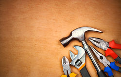 Set of manual tools over a wood panel Stock Image