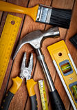 Set of manual tools on a wooden floor Stock Image