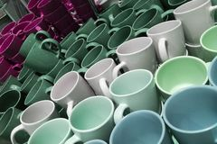 Set of many empty cups different colors abstract background. Set of many empty cups different colors abstract stock images