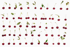 Set from many ripe red cherries arranged on white Royalty Free Stock Images