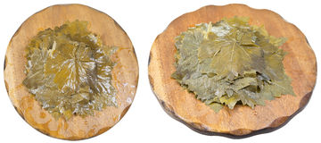 Set of marinated grape leaves on wooden boards Stock Photography