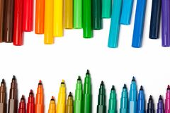 Set of markers with open covers. Isolated on the white background. A bright picture on the theme of drawing, education, school, creativity Royalty Free Stock Photography